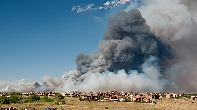 Colorado fires force thousands to flee