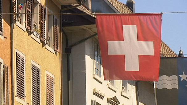 Switzerland town accused of 'apartheid' over planned restrictions on asylum-seekers