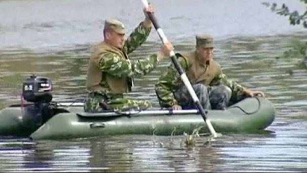 [Immagine: 606x341_235754_russia-inondazioni-devast...1376796972]