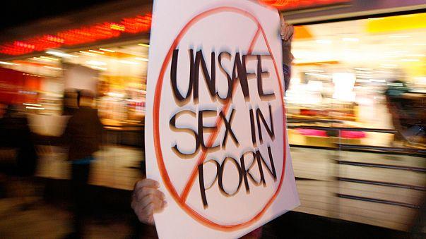 Porn actors stop work after positive HIV test