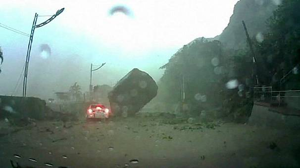 Captured on video: amazing escape in Taiwan landslide