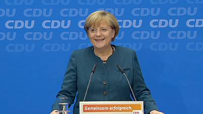 Triumphant Merkel seeks coalition talks with rivals SPD in Germany