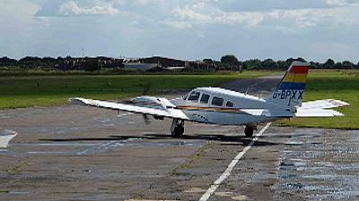 Passenger miraculously lands light aircraft after pilot falls ill at controls