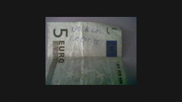 Message in a banknote for angry Spaniards