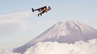 Spectacular: 'Jetman' Yves Rossi flies past Mount Fuji in Japan
