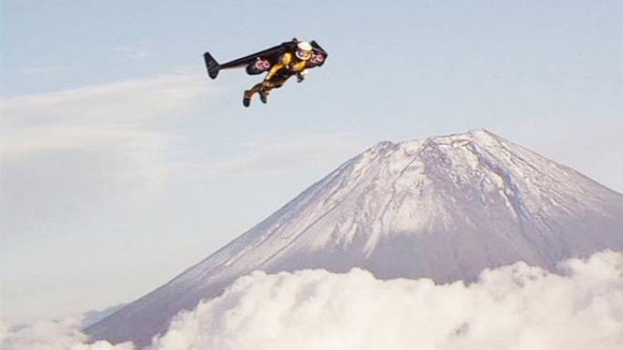 Spectacular: 'Jetman' Yves Rossi flies past Mount Fuji in Japan