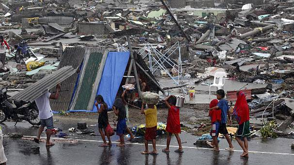 Struggle for survival in Tacloban, Philippine city flattened by Haiyan