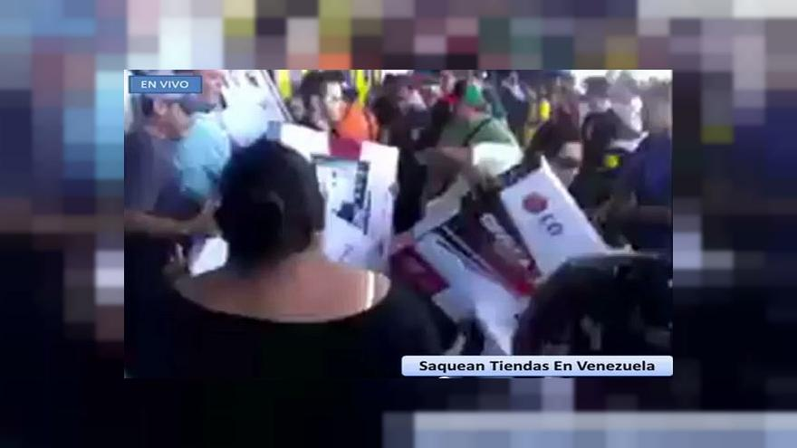 Watch: Looting in Venezuela after government launches attack on 'bourgeois parasites'