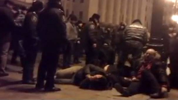 Ukrainian police filmed beating anti-government protesters