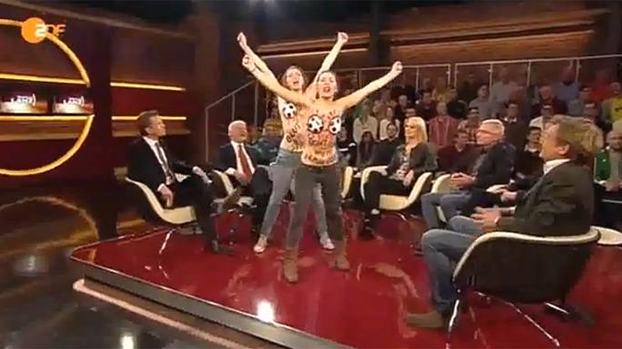 Topless FEMEN protesters storm German football TV show