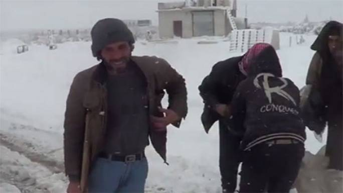Two children freeze to death in Syria as snow storms sweep across Middle East