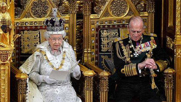 Britain's Queen Elizabeth goes nuts over nibbles at Buckingham Palace