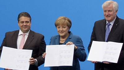 Merkel celebrates coalition deal with Social Democrats