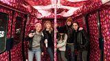 Artists wrap Paris Metro train in Christmas paper for festive stunt