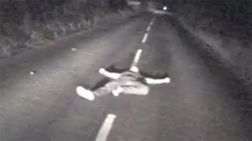Watch: Drunk man seconds from death after lying down in middle of British road