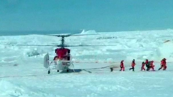 Helicopter rescues passengers on stranded Antarctic ship