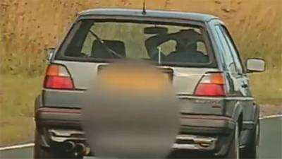 Motorist in Britain caught driving with both hands behind his head