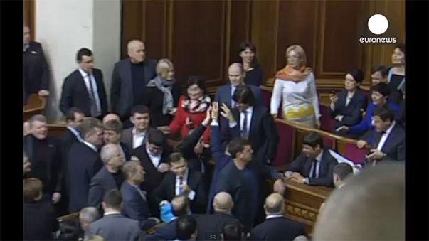 Watch: Ukrainian deputies throw rice and buckwheat in Parliament