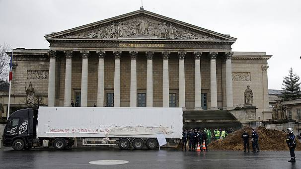 Watch: Dirty protest as huge pile of manure dumped at France's National Assembly