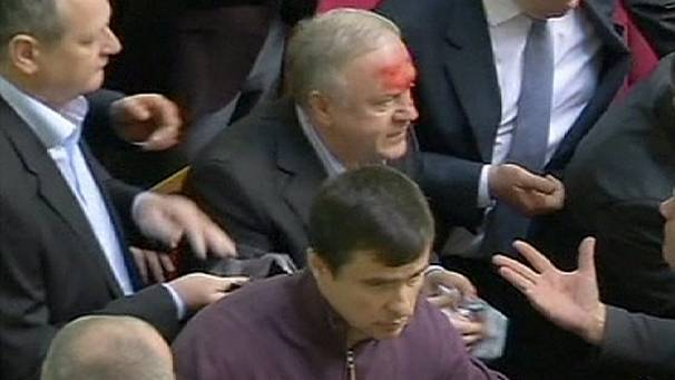 Clashes inside Ukraine parliament as MPs pass strict anti-protest laws