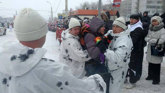 Russian LGBT activist arrested for waving a rainbow flag at Olympic torch relay