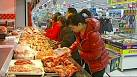 Chinese inflation tame, producer prices fall again
