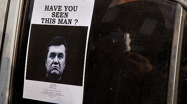 Ukraine police hunt for Yanukovych, charged with mass murder