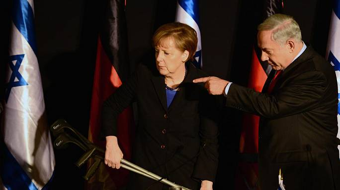 Unfortunate photo sees Angela Merkel given apparent Hitler moustache
