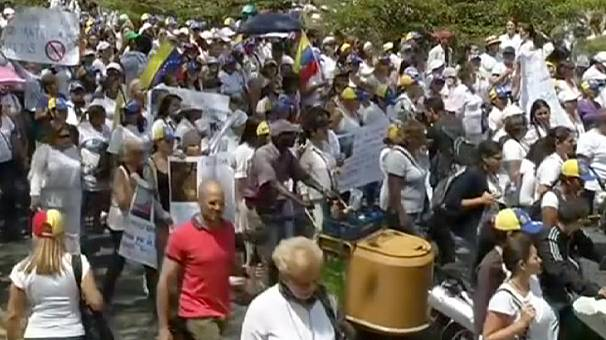 Venezuela's president calls for national peace conference as protests continue
