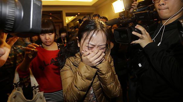 Relatives of passengers on missing Malaysia aircraft accuse authorities of negligence