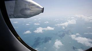 As it happened: Malaysia's flight mystery remains as searches extended to Malacca Strait