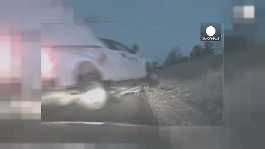 Watch: Crashing pick-up truck flies threw air just missing police officer