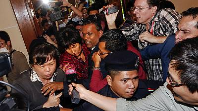 Missing flight MH370: grieving families receive first compensation payouts