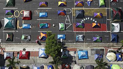 Protesters camp out in Caracas