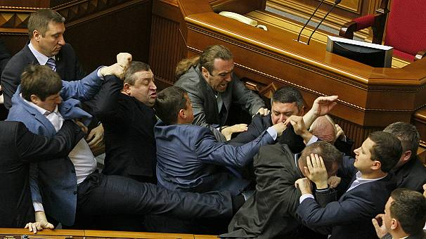Brawl in Ukraine parliament as tensions rise in east
