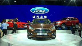 Rival car makers roll out top models at Auto China show