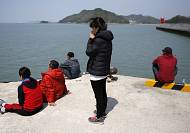 South Korean president says ferry crews' actions 'like an act of murder' amid fresh arrests