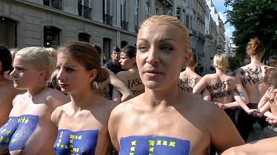 Femen hold topless protest outside National Front campaign launch