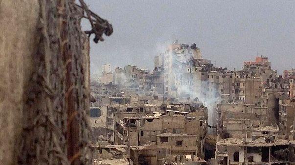 Homs in ruins as Syrian rebels leave