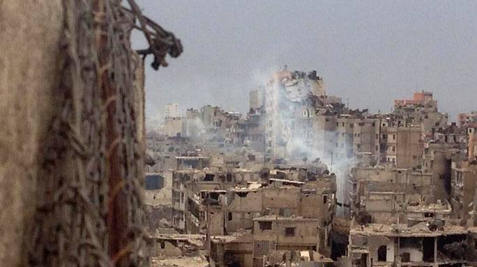 Homs in ruins as Syrian rebels leave
