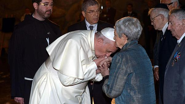 Pope Francis kisses hands of Holocaust survivors