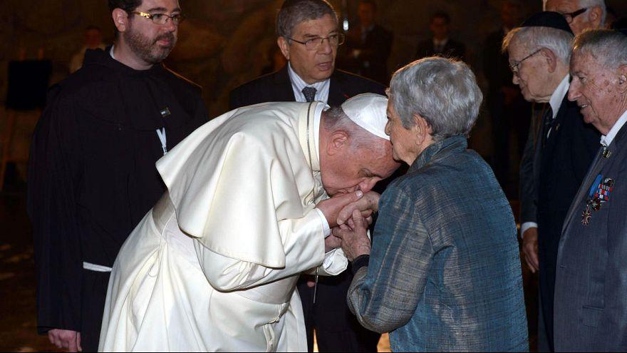 Pope Francis kisses hands of Holocaust survivors