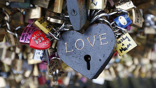 Heavy heart? Paris bridge panel falls under weight of 'love locks'