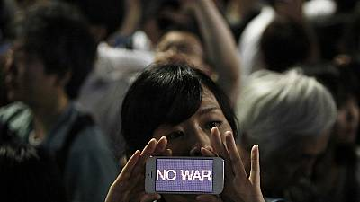 Woman protests against Japan's new military role
