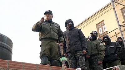 Bolivian police fire tear gas in a push for a salary increase