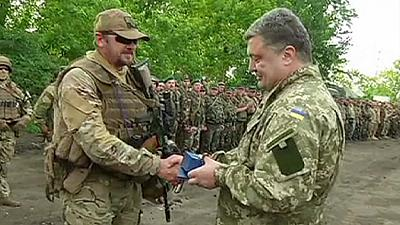 Ukrainian President awards medals to nationalist soldiers – nocomment