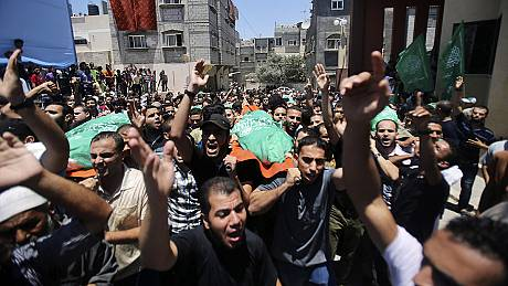 Gaza mourns its dead as Israel cranks up its military build-up