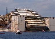 Costa Concordia leaving wreck site to be towed to Genoa
