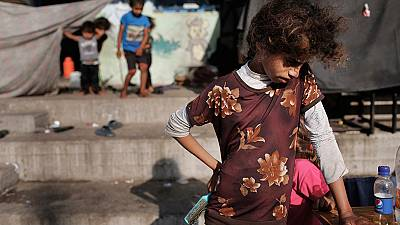 where to go?  Palestine children after an attack on UN school in Gaza