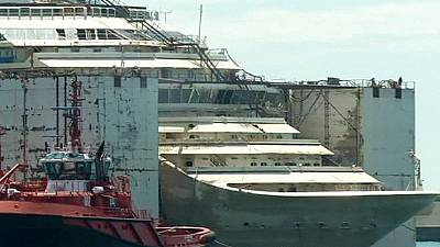 Costa Concordia wreck docks in Genoa
